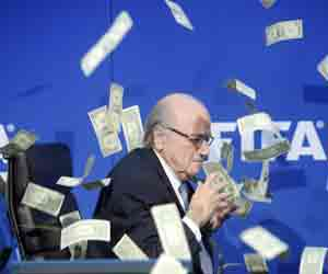 sepp blatter Prankster showers  fake dollar bills at Fifa press conference